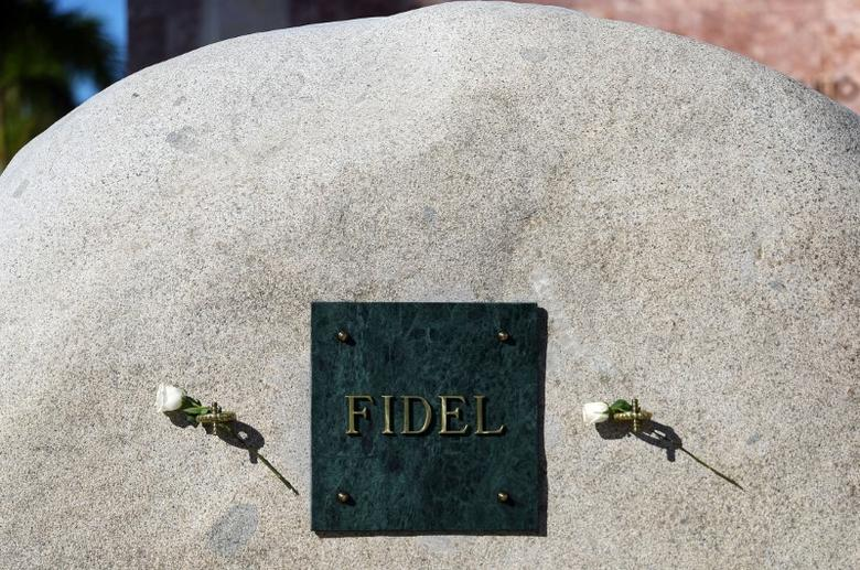 A plaque with the name of Cuba's former President Fidel Castro is seen on a granite boulder where Castro's ashes were encased at the Santa Ifigenia Cemetery, in Santiago de Cuba, December 5, 2016. REUTERS/Ivan Alvarado