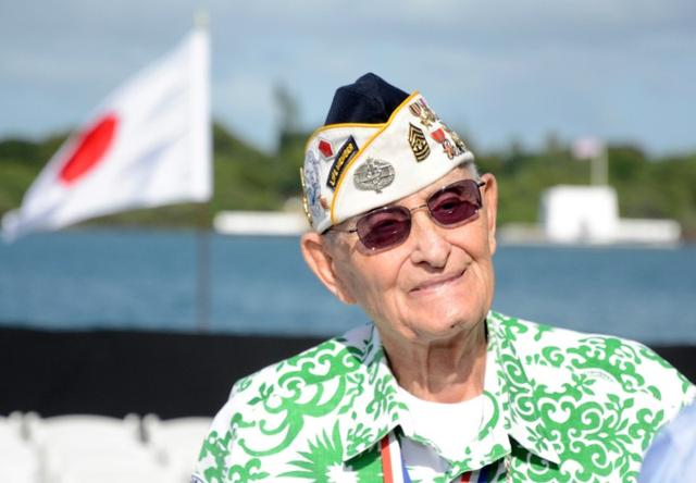 Pearl Harbor survivor Sterling Cale talks to reporters before U.S. President Barack Obama and Japanese Prime Minister Shinzo Abe deliver remarks at the USS Arizona Memorial at Joint Base Pearl Harbor-Hickam in Honolulu, Hawaii, December27, 2016. REUTERS/Hugh Gentry