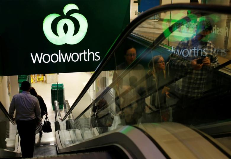 Shoppers ride an escalator into and out of a Woolworths store in central Sydney, Australia, July 25, 2016.     REUTERS/Steven Saphore