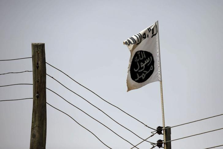A Boko Haram flag flies in Damasak, Nigeria March 24, 2015. REUTERS/Joe Penney/File Photo