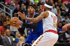 Dec 28, 2016; Atlanta, GA, USA; New York Knicks forward Carmelo Anthony (7) looks to shoot while guarded by Atlanta Hawks guard Malcolm Delaney (5) during the first half at Philips Arena. Mandatory Credit: Dale Zanine-USA TODAY Sports