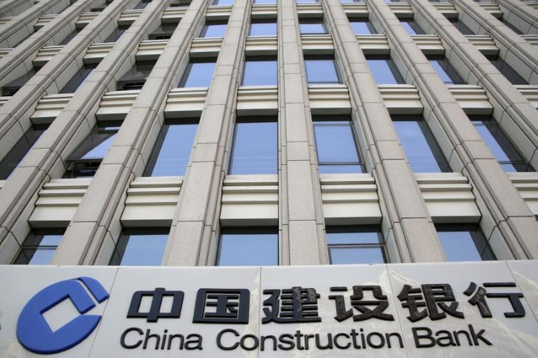 A sign of China Construction Bank is seen at a branch in Beijing, China, April 21, 2016. REUTERS/Kim Kyung-Hoon/File