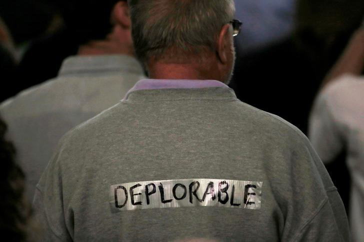 A supporter of  Donald Trump wears tape with the word ''deplorable'' written on it in the audience at a campaign rally in Laconia, New Hampshire, U.S., September 15, 2016.  REUTERS/Mike Segar