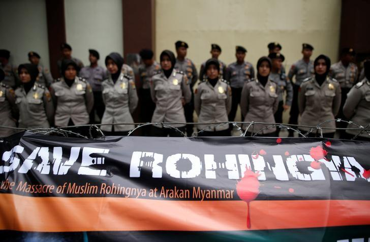A banner is tied to barbed-wire outside the Myanmar embassy during a protest against what organisers say is the crackdown on ethnic Rohingya Muslims in Myanmar, in Jakarta, Indonesia November 25, 2016.   REUTERS/Darren Whiteside/Files