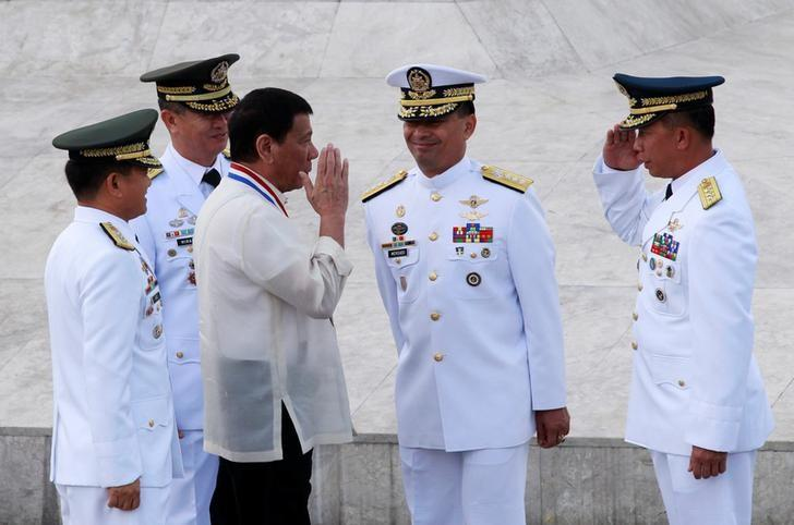 President Rodrigo Duterte returns the salute of a military officer as he leads the death anniversary celebration of Filipino national hero Dr Jose Rizal in Manila, Philippines December 30, 2016.  REUTERS/Czar Dancel