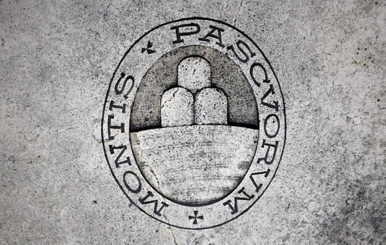 A logo of Monte dei Paschi di Siena bank is seen on the ground in Siena, Italy, November 5, 2014. REUTERS/Giampiero Sposito/Files
