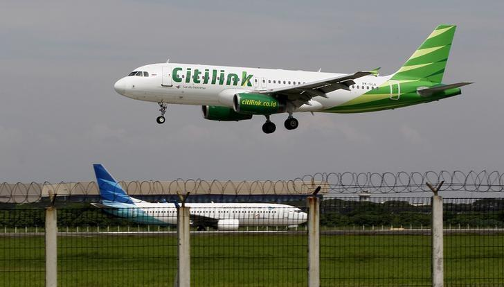 A Citilink Airbus A320 approaches for a landing at Soekarno–Hatta International Airport in Jakarta June 14, 2013. REUTERS/Enny Nuraheni/Files