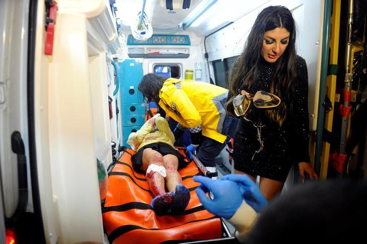 ATTENTION - VISUAL COVERAGE OF SCENES OF INJURY OR DEATH An injured woman is carried to an ambulance from a nightclub where a gun attack took place during a New Year party in Istanbul, Turkey, January 1, 2017. Murat Ergin/Ihlas News Agency via REUTERS