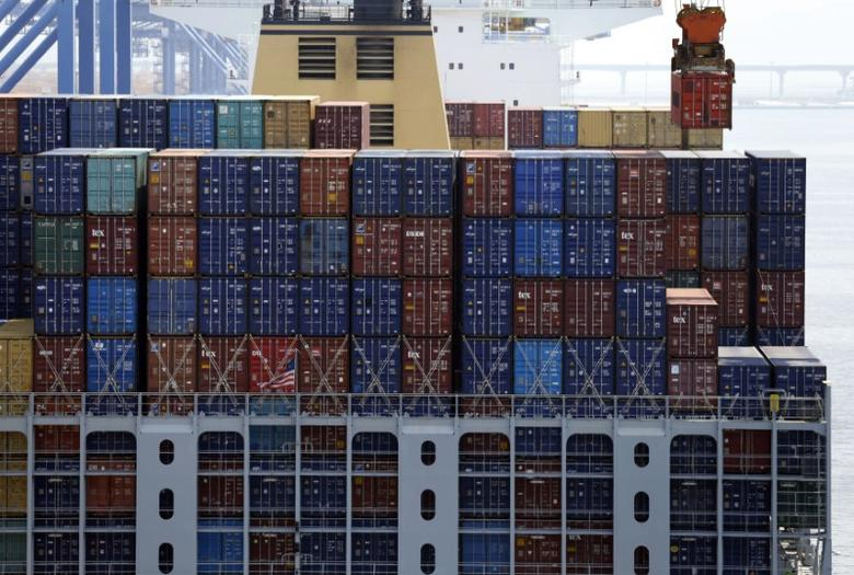 A crane carries a container (top R) from a ship at the PNC container terminal at the Busan New Port in Busan, about 420 km (261 miles) southeast of Seoul, August 8, 2013.  REUTERS/Lee Jae-Won/Files