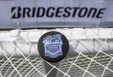 Jul 29, 2015; Foxboro, MA, USA; A Winter Classic puck rests on the net after a press conference for the Winter Classic hockey game at Gillette Stadium. Mandatory Credit: Bob DeChiara-USA TODAY Sports