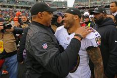 Jan 1, 2017; Cincinnati, OH, USA; Cincinnati Bengals head coach Marvin Lewis (left) hugs Baltimore Ravens wide receiver Steve Smith (right) after their game at Paul Brown Stadium. Mandatory Credit: Aaron Doster-USA TODAY Sports