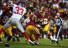 Jan 1, 2017; Landover, MD, USA; Washington Redskins running back Robert Kelley (32) rushes the ball as New York Giants safety Andrew Adams (33) defends during the second half at FedEx Field. Mandatory Credit: Brad Mills-USA TODAY Sports