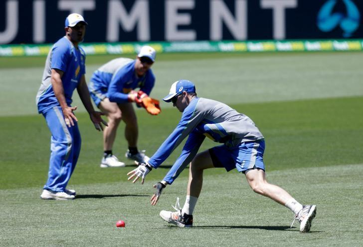 Cricket - Australia v South Africa - Third Test cricket match - Adelaide Oval, Adelaide, Australia - 23/11/16. Australian test debutante Peter Handscomb drops the ball as Usman Khawaja (L) and wicketkeeper Matthew Wade watch during practice at the Adelaide Oval.  REUTERS/Jason Reed/Files