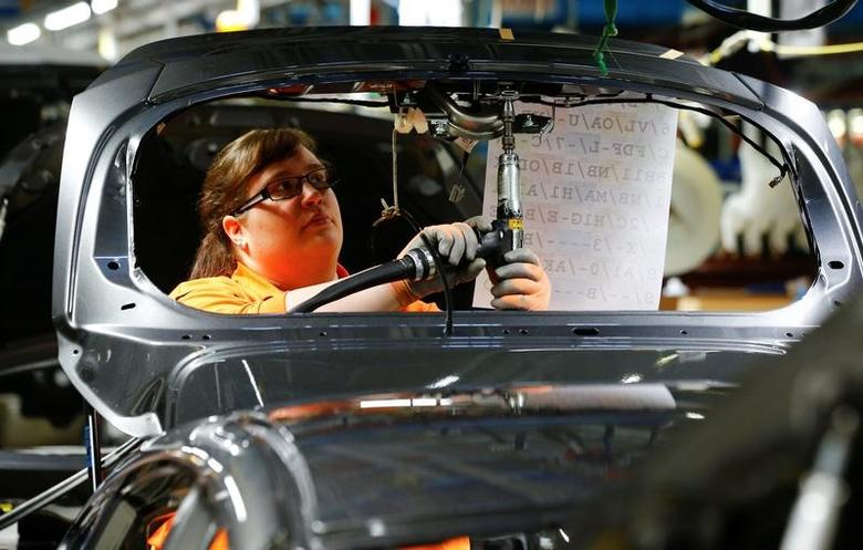 A woman is pictured at work at the Ford Fiesta assembly line in Cologne, Germany January 6, 2016.    REUTERS/Wolfgang Rattay