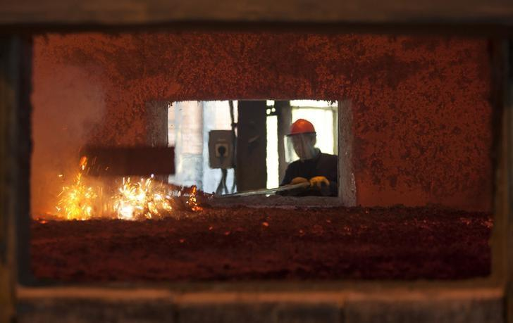 An employee operates an aluminium furnace at the foundry in Montenegro's Kombinat Aluminijuma Podgorica (KAP) aluminium factory in Podgorica September 9, 2013. REUTERS/Stevo Vasiljevic/Files