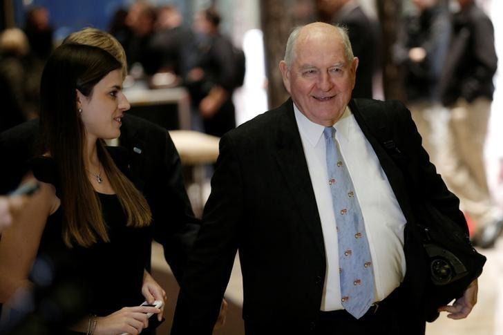 Former Georgia Governor Sonny Perdue is escorted by Madeleine Westerhout as he arrives for a meeting with U.S. President-elect Donald Trump at Trump Tower in New York, U.S., November 30, 2016. REUTERS/Mike Segar/Files