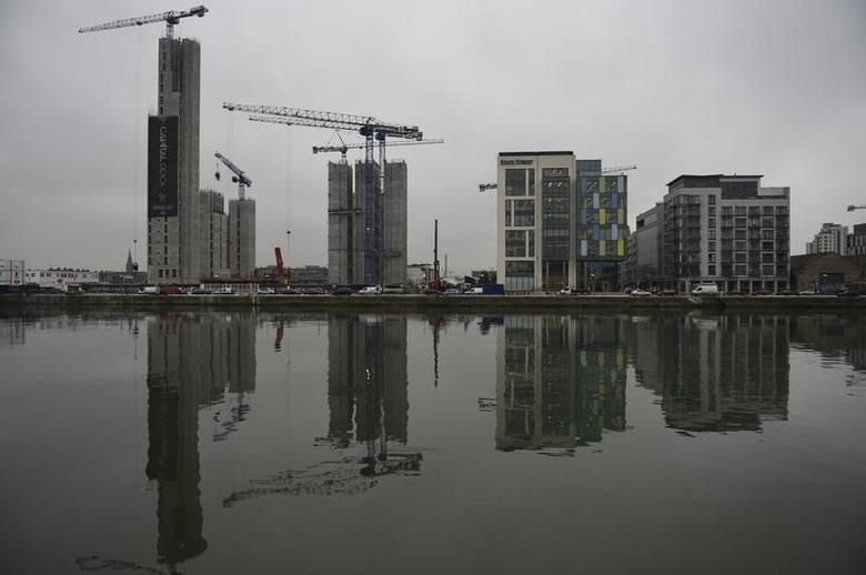 Office buildings under construction are reflected in the water in the Capital Dock area of Dublin, Ireland December 5, 2016. REUTERS/Clodagh Kilcoyne