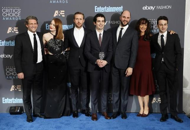 (L-R) Producer Gary Gilbert, actors Emma Stone and Ryan Gosling, director Damien Chazelle, producer Jordan Horowitz, costume designer Mary Zophres and composer Justin Hurwitz pose backstage with their award for Best Picture for 'La La Land'' during the 22nd Annual Critics' Choice Awards in Santa Monica, California, U.S., December 11, 2016.  REUTERS/Danny Moloshok