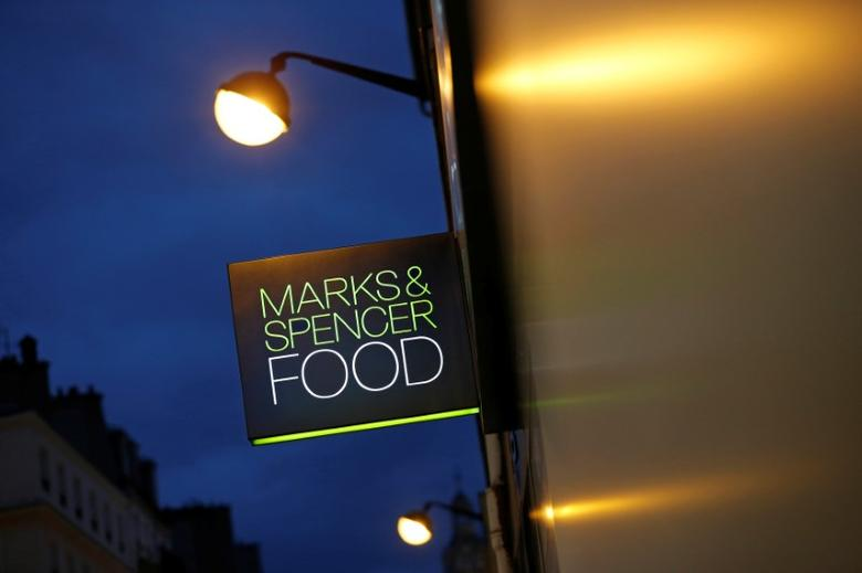 A Marks & Spencer logo is seen in front of one of their food stores in Paris, France, November 8, 2016. REUTERS/Christian Hartmann