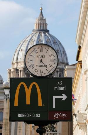 A McDonald's sign is seen at Via della Conciliazione street in Rome, Italy in front of Vatican City's St. Peter's Square January 3, 2017. REUTERS/Alessandro Bianchi