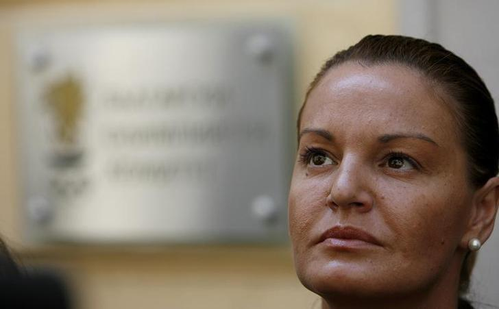 Stefka Kostadinova, chairwoman of the Bulgarian Olympic Committee, listens to journalists' questions outside the Committee building in central Sofia June 30, 2008. REUTERS/Stoyan Nenov/File Photo