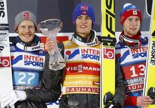 Ski Jumping - 65th four-hills ski jumping tournament first round - Innsbruck - 04/01/2017 - Norway's Daniel Andre Tande, his compatriot Robert Johanssone and Russia's Evgeniy Klimov react on the winners podium.  REUTERS/Dominic Ebenbichler