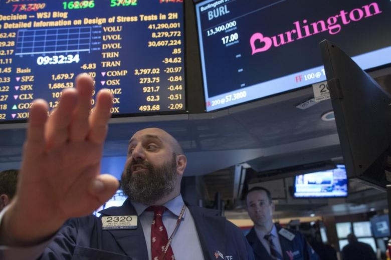 Senior floor official Peter Giacche gives a price during the initial public offering (IPO) of Burlington Stores Inc. on the floor of the New York Stock Exchange, October 2, 2013. REUTERS/Brendan McDermid