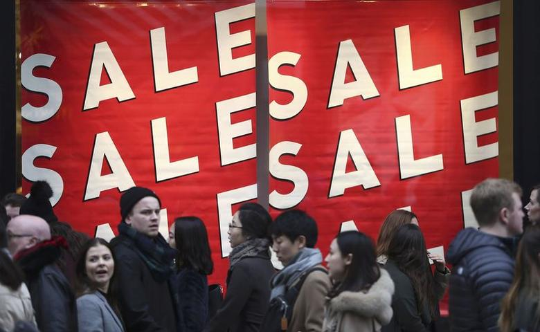 Shopper pass a sale sign on Oxford Street in London, Britain December 18, 2016. REUTERS/Neil Hall