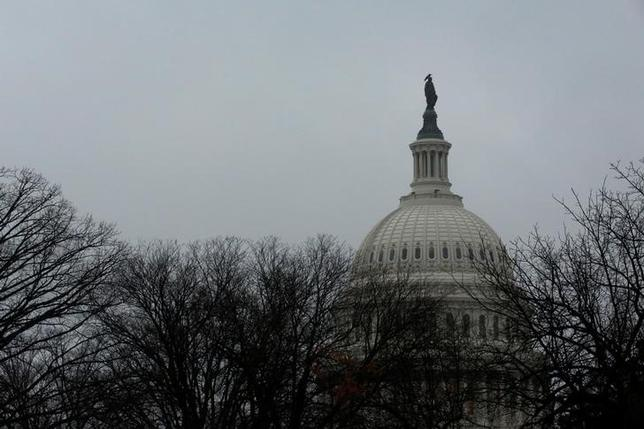 A rainy, gray sky tops the U.S. Capitol dome on the first day of the new session of Congress in Washington, U.S. January 3, 2017. REUTERS/Jonathan Ernst/Files