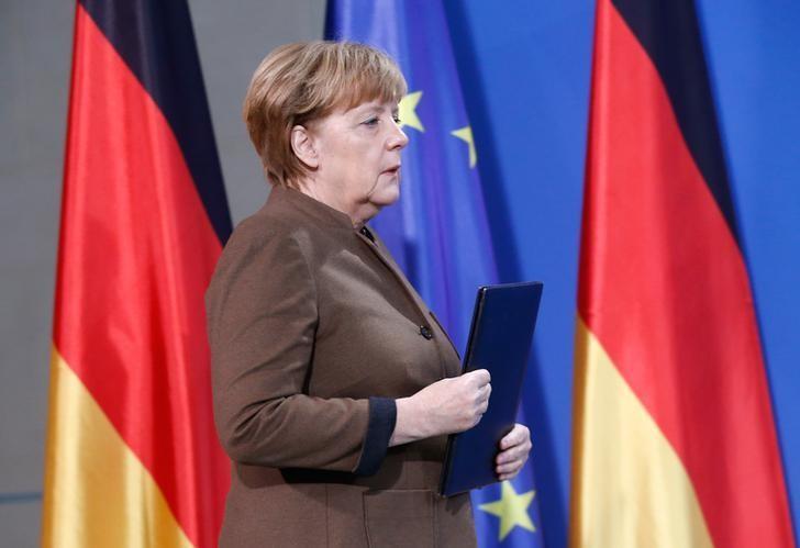 German Chancellor Angela Merkel walks before delivering a statement in Berlin, Germany, December 23, 2016.  REUTERS/Hannibal Hanschke