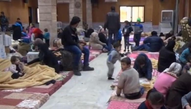 A still image taken from a video obtained by Reuters, said to be shot on January 4, 2017, shows civilians, who were evacuated from Wadi Barada, sitting inside a shelter in the Damascus suburb of Rawda, Syria. REUTERS TV/via REUTERS