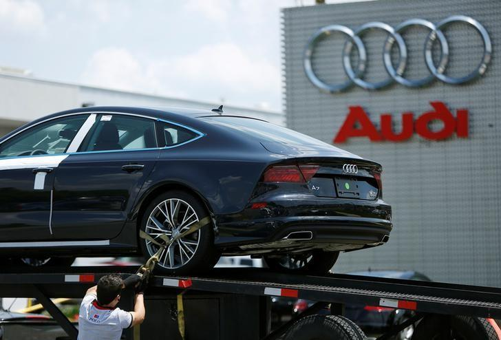 A transport driver unloads a new Audi A7 Sedan at a dealer's lot in Silver Spring, Maryland, U.S. June 1, 2016. REUTERS/Gary Cameron/Files