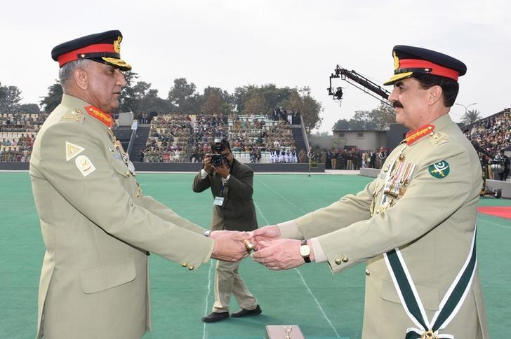Pakistan's outgoing Army Chief Gen. Raheel Sharif (R) hands over a ceremonial baton to his successor Gen. Qamar Javed Bajwa during the Change of Command ceremony in Rawalpindi, Pakistan, November 29, 2016. Pakistan Inter Services Public Relations (ISPR)/Handout via REUTERS
