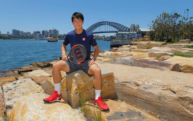 Tennis player Kei Nishikori of Japan poses for the cameras in front of the Sydney Harbour Bridge in Sydney, January 9, 2017 before the Australian Open tennis tournament in Melbourne begins January 16.  REUTERS/Jason Reed