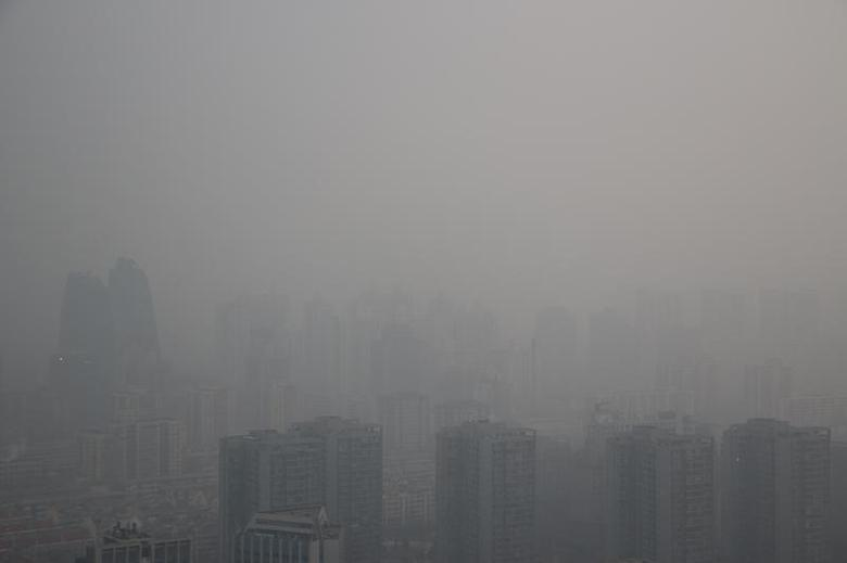 Buildings are seen among smog during a polluted day in Beijing, China, January 6, 2017. REUTERS/Stringer