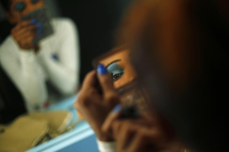 An aspiring model does her make up before auditioning for a transgender/transsexual modelling agency set to open in New Delhi, February 7, 2016. REUTERS/Adnan Abidi/Files