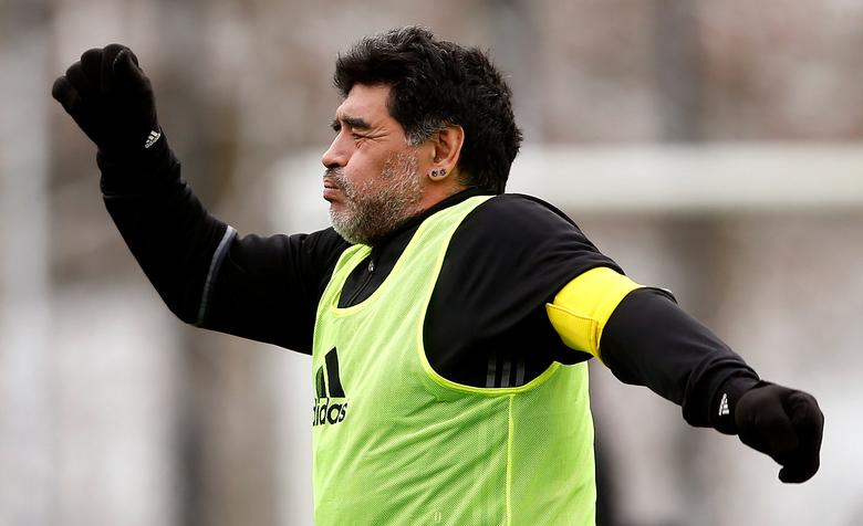 Diego Armando Maradona warms-up before the FIFA Legends tournament ahead of the FIFA awards ceremony in Zurich, Switzerland, January 9, 2017. REUTERS/Arnd Wiegmann