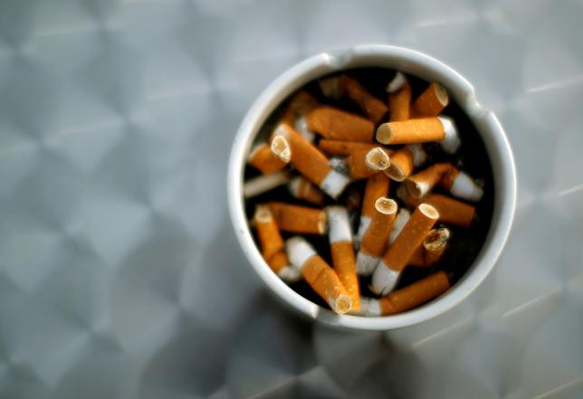 FILE PHOTO: An ash tray with cigarette butts is pictured in Hinzenbach, Austria, February 5, 2012.  REUTERS/Lisi Niesner/File Photo
