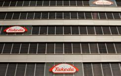 Logos of Japanese Takeda Pharmaceutical Co are seen at an office building in Glattbrugg near Zurich March 7, 2012.   REUTERS/Arnd Wiegmann/File Photo   - RTX2RH16
