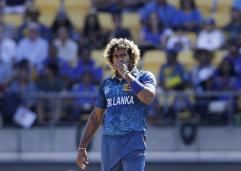 Sri Lanka's Lasith Malinga reacts after his delivery was hit by England's Moeen Ali (not pictured) during their Cricket World Cup match in Wellington, March 1, 2015.    REUTERS/Anthony Phelps