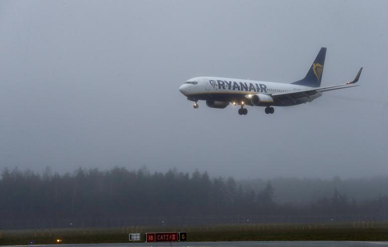 A Ryanair aircraft lands during a foggy day on Riga International Airport in Riga, Latvia, December 21 2016. REUTERS/Ints Kalnins