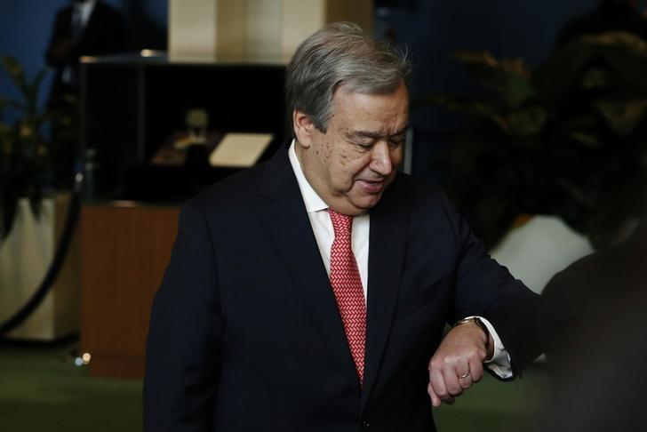United Nations Secretary-General-designate Mr. Antonio Guterresm of Portugal checks his watch before answering questions from the media after his swearing in at U.N. headquarters in New York, U.S., December 12, 2016. REUTERS/Lucas Jackson