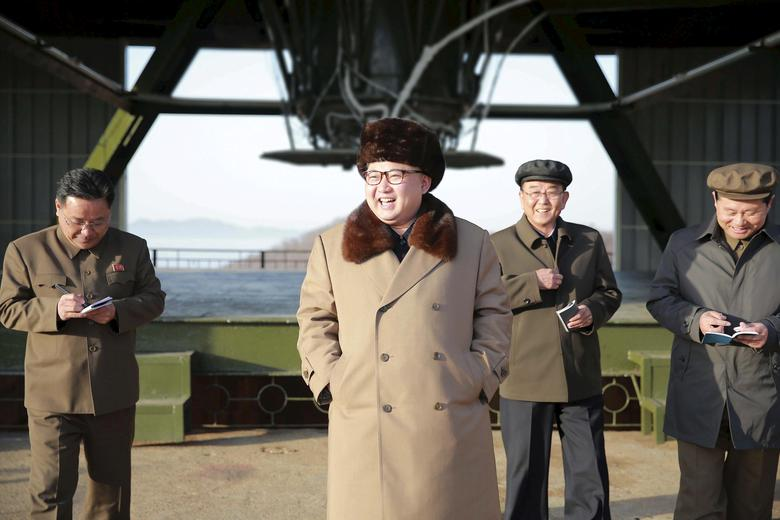 Kim Jong Un smiles as he visits Sohae Space Center in Cholsan County, North Pyongan province for the testing of a new engine for an intercontinental ballistic missile (ICBM) in this undated photo released April 9, 2016. KCNA/via REUTERS