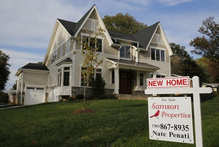 A real estate sign advertising a new home for sale is pictured in Vienna, Virginia, outside of Washington, October 20, 2014.       REUTERS/Larry Downing/File Photo
