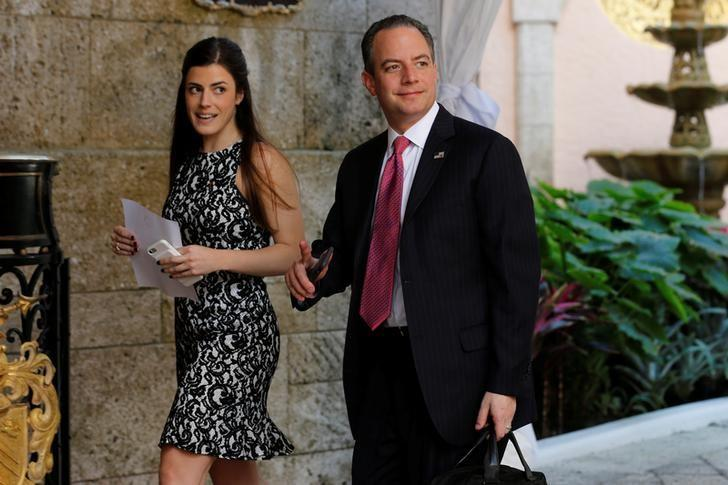 Reince Priebus (R), chief of staff to U.S. President-elect Donald Trump, walks with a staff member as he arrives to attend meetings with Trump at the Mar-a-lago Club in Palm Beach, Florida, U.S. December 28, 2016. REUTERS/Jonathan Ernst