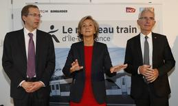 (LtoR) Henri Poupart-Lafarge, Chairman and Chief Executive Officer of Alstom, Valerie Pecresse, President of the Ile-de-France region, French state-owned railway company SNCF CEO Guillaume Pepy attend a news conference in Paris after French authorities announced that an Alstom and Bombardier consortium has won a French train contract estimated to be worth 1.16 billion euros ($1.22 billion) for the consortium, France, January 11, 2017. REUTERS/Gonzalo Fuentes