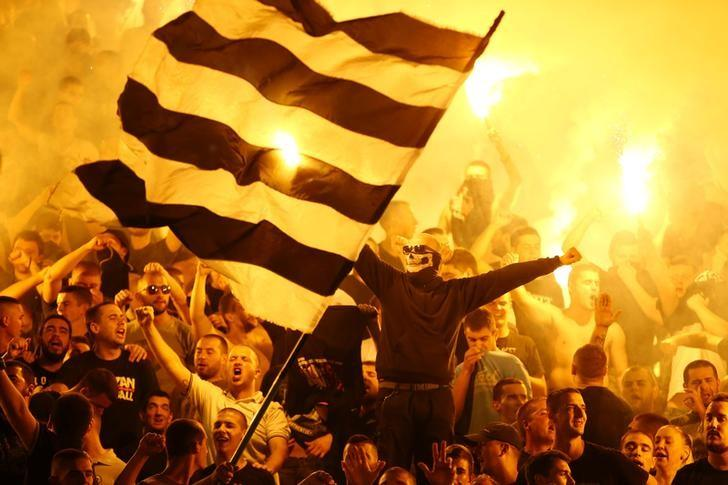 Football Soccer Serbia - Partizan Belgrade v Red Star Belgrade - Super liga - Partizan Belgrade Stadium, Belgrade, Serbia - 17/9/16 Partizan Belgrade's fans cheer during the match. REUTERS/Marko Djurica/Files