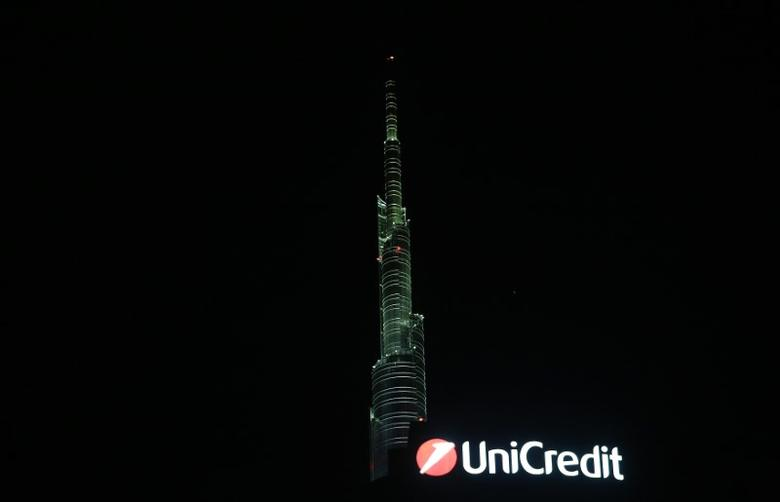 The Unicredit bank logo is seen on top of the headquader at the Porta Nuova district downtown Milan , Italy, March 10, 2016.  REUTERS/Stefano Rellandini