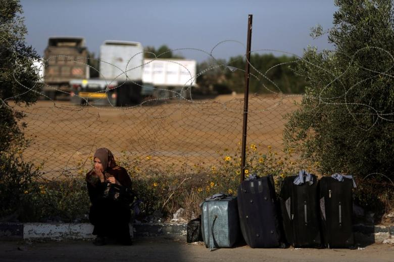 A woman waits for a travel permit to cross into Egypt through the Rafah border crossing after it was opened by Egyptian authorities on Wednesday for five days, in the southern Gaza Strip June 30, 2016. REUTERS/Ibraheem Abu Mustafa