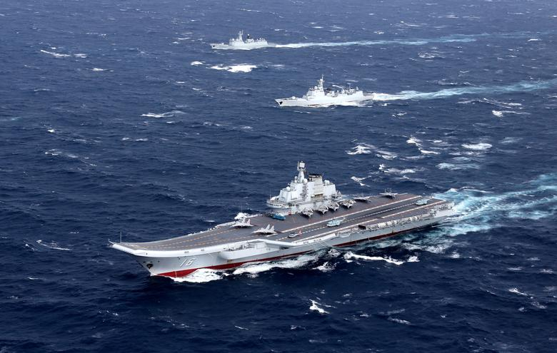 FILE PHOTO: China's Liaoning aircraft carrier with accompanying fleet conducts a drill in an area of South China Sea, in this undated photo taken December, 2016. REUTERS/Stringer/File photo